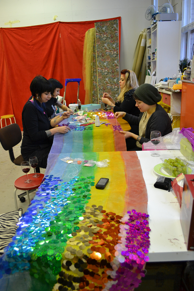 Sewing a rainbow with 10,000 hand-sewn sequins. © Tiitta Räsänen