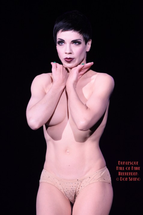 Laurie Hagen performing her reverse striptease at The Burlesque Hall of Fame Weekend 2013. ©Don Spiro