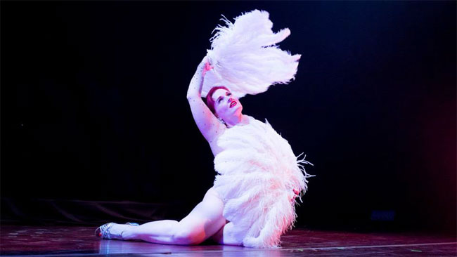 Lady Ginger performing her 'Moonglow' fan dance.  ©Mike White (All I Want for Christmas: Michelle L'amour and the Chicago Starlets)