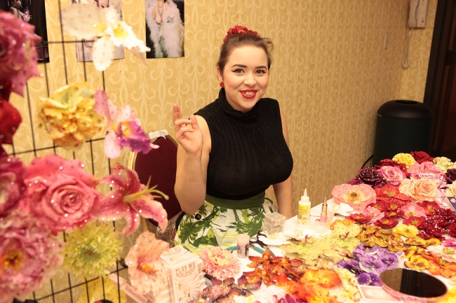 Amber Ray selling her beautiful hair flowers at BurlyCon 2013.  ©Don Spiro