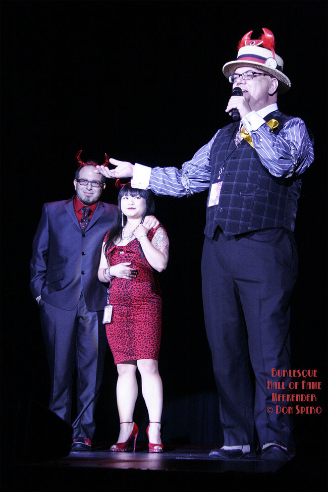 Mig Ponce, Joyce Tang and Jim Sweeney leading tributes to Sparkly Devil at the Burlesque Hall of Fame Weekend 2013.  ©Don Spiro