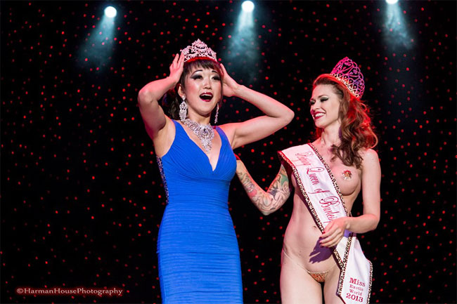 Midnite Martini is crowned Miss Exotic World, Reigning Queen of Burlesque 2014, by last year's Reigning Queen, LouLou D'vil.  ©Chris Harman/Harman House Photography