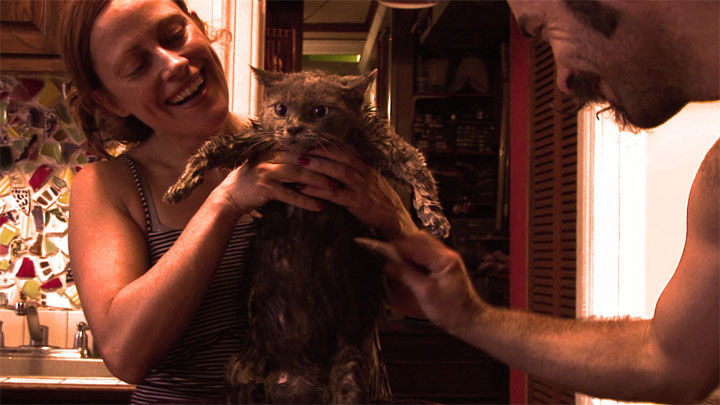Trixie and Monkey washing their cats in documentary Us, Naked: Trixie and Monkey.  ©Kirsten Hollander
