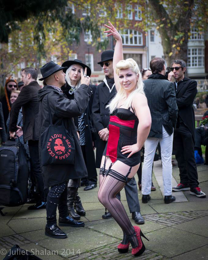 Lydia Darling (centre), other members of the London cabaret community and Soho residents and supporters gathered in Soho Square Gardens before the procession began. ©Juliet Shalam