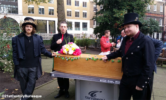 Pallbearers Ed Gosling, Benjamin Louche and James Lee prepare to carry the coffin in the procession to Madame Jojo's.   ©Holli-Mae Johnson/21st Century Burlesque