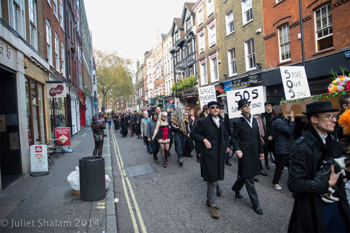 The procession began in Soho Square and then through Greek Street to stop at the Soho Estates offices before continuing to Madame Jojo's. ©Juliet Shalam