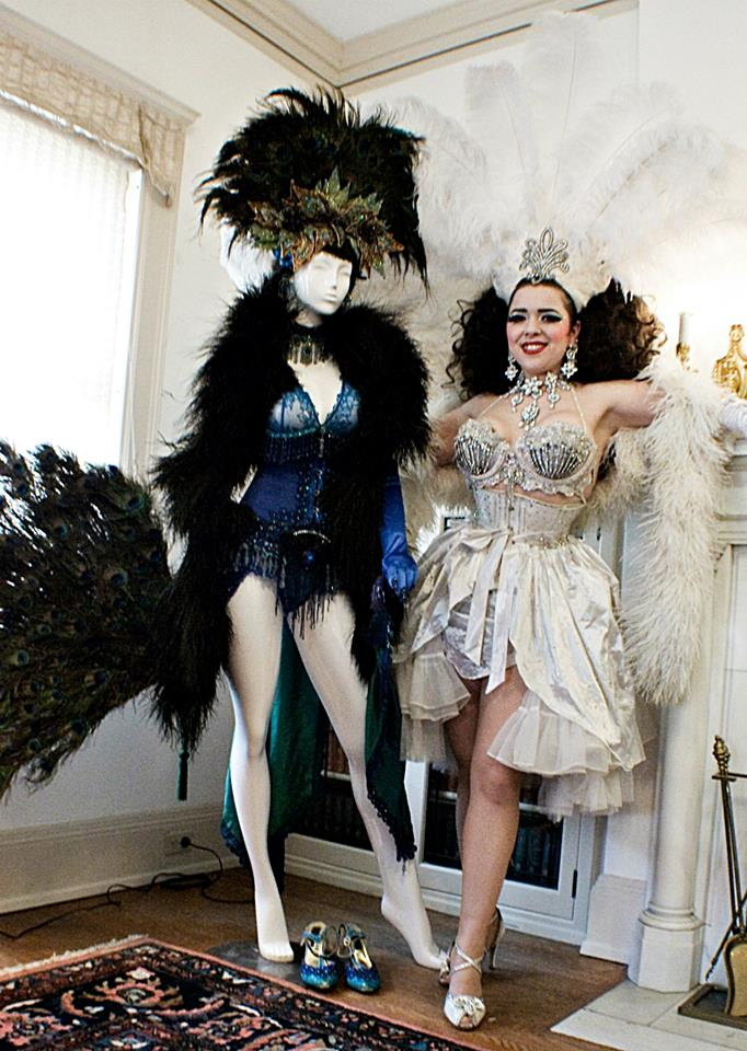 Amber Ray next to her peacock costume at the 'More on Less: The History of Burlesque in America From Lydia Thompson to Amber Ray' exhibition.  ©Richard Boss Perez