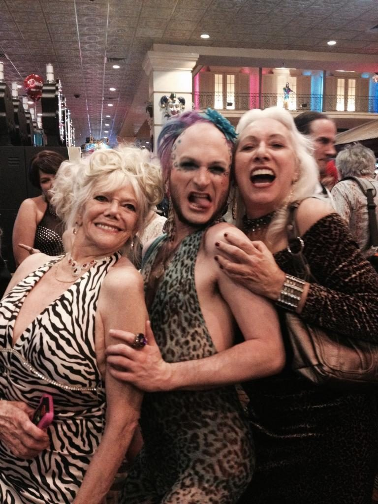 EmpeROAR Fabulous! (Seattle) caught in a Burlesque Legend Sandwich with Ellion Ness (L) and Viva La Fever (R)!  ©Minnie Tonka