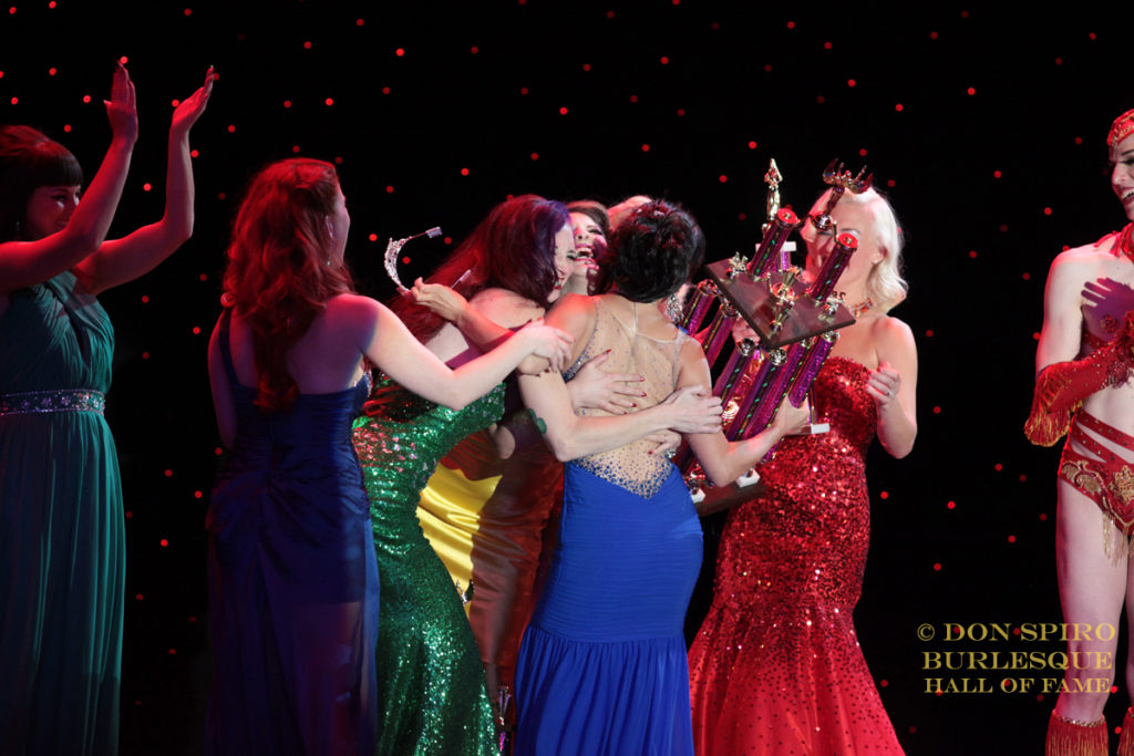 The Ruby Revue embrace Midnite Martini as she is crowned Miss Exotic World, Reigning Queen of Burlesque 2014. ©Don Spiro
