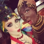 Janet Fischietto (not part of the act in question) posing with German performer Mele Kapunkt, who performed a duet with fellow performer Stormy Heather. (Blackface in Burlesque. Again. 21st Century Burlesque Magazine)