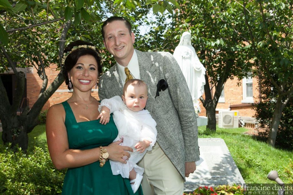 Angie Pontani, Brian Newman and daughter Sistilia at her christening. (Copyright Angie Pontani)
