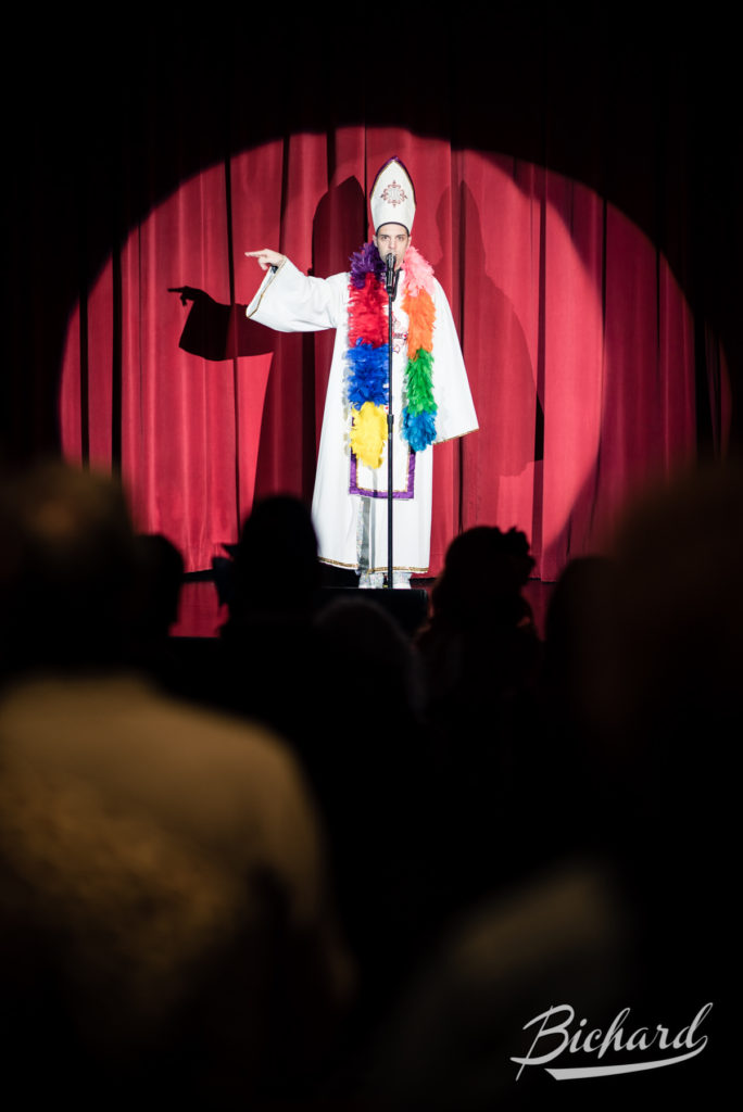 The Bishop of Burlesque, David Bishop, leads the crowd in his customary burlesque blessing at the Movers, Shakers and Innovators showcase at the Burlesque Hall of Fame Weekend 2016. Image copyright John-Paul Bichard.
