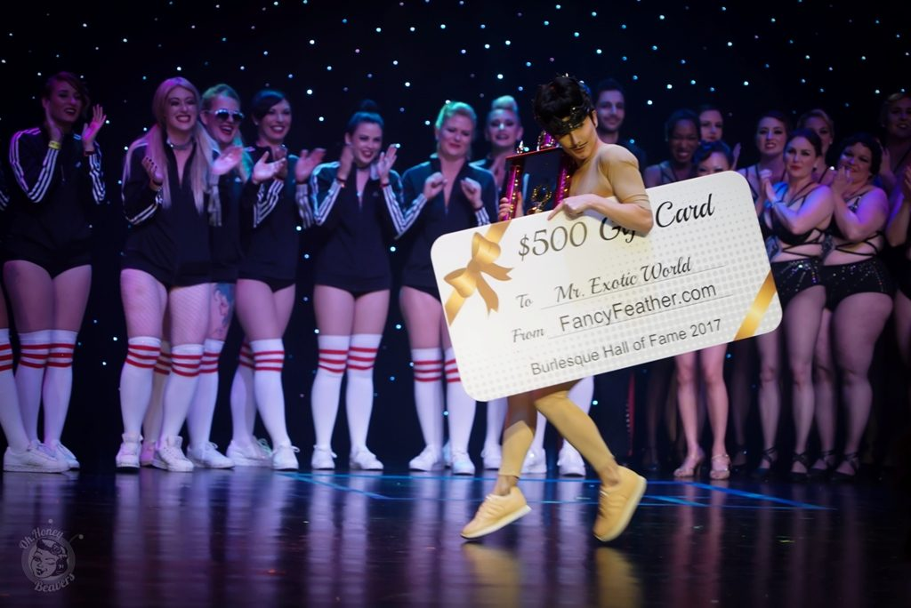 Best Boylesque Lou Henry Hoover with a cheque from Fancy Feather at the Burlesque Hall of Fame Weekend 2017. Image by Honey Beavers, exclusively for 21st Century Burlesque Magazine