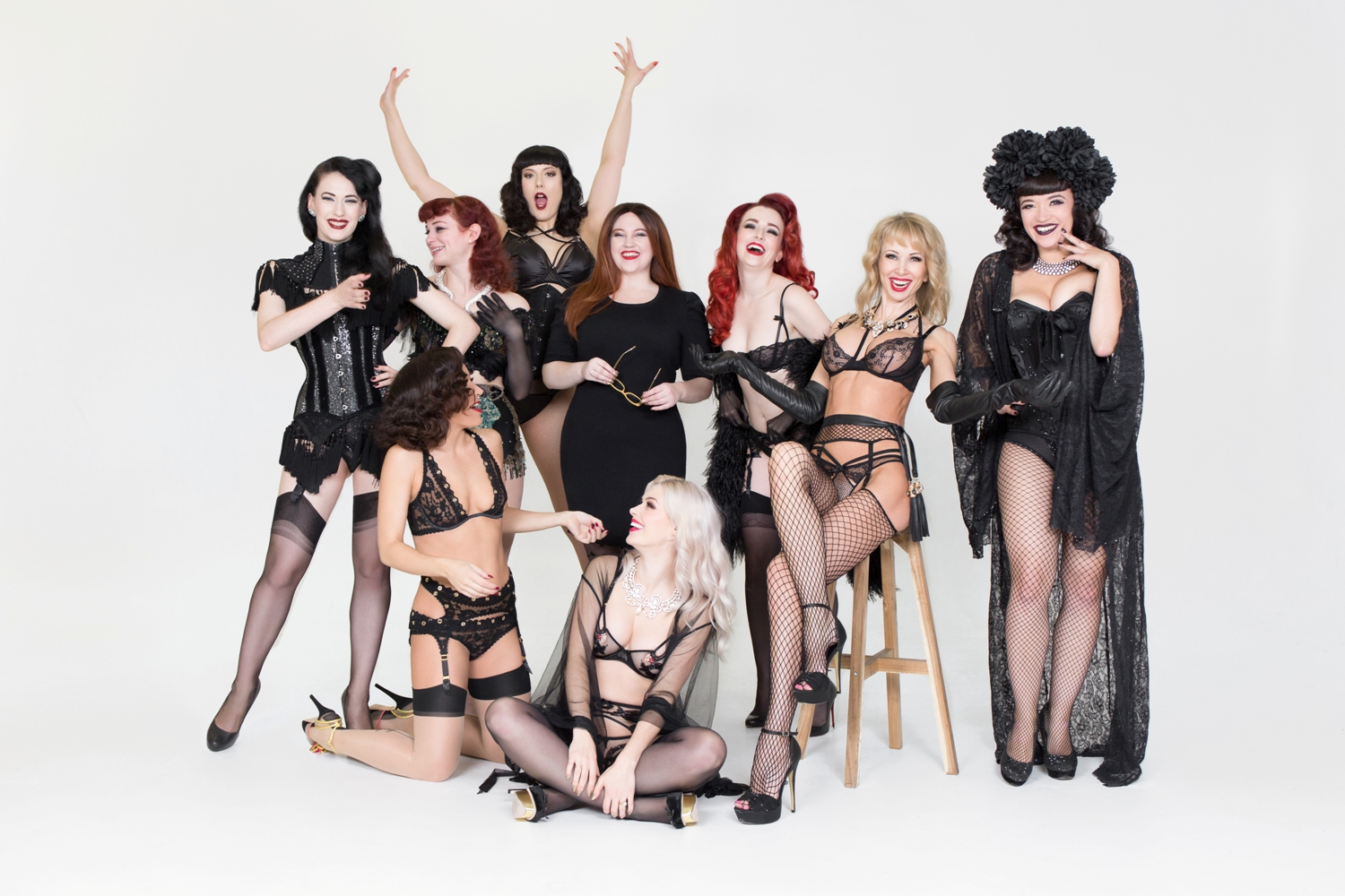 Editor-in-Chief of 21st Century Burlesque Magazine, Holli Mae Johnson (centre) with (clockwise from bottom centre) Beau Rocks, Kitty Bang Bang, Betsy Rose, Vicky Butterfly, Lady May, Polly Rae, Dinah Might and Bettsie Bon Bon. © Tigz Rice 2017.